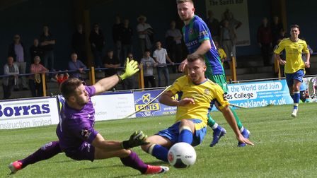Darren Foxley of St Albans City is denied by Dorking Wanderers' keeper Slavomir Huk. Picture: JIM ST