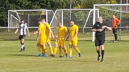 Colney Heath celebrate the first of Spencer Clarke-Mardel's two goals in the win at Long Melford in