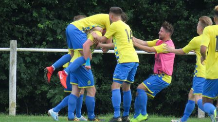 Harpenden Town celebrate their late winner against Leighton Town. Picture: RAY CANHAM