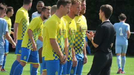 Harpenden Town line-up to defend a free-kick against Leighton Town. Picture: RAY CANHAM