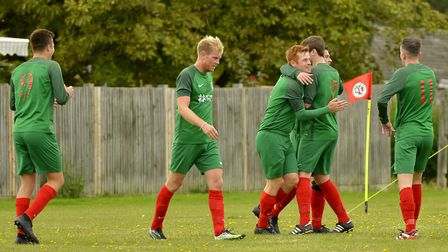 Huntingdon United players celebrate a goal against Witchford 96. Picture: DUNCAN LAMONT