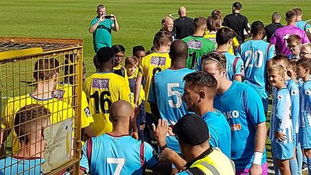 St Albans City and Wymouth teams head out onto the Clarence Park pitch ahead of the National League