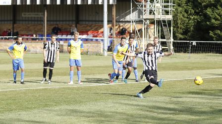 Ben Seymour-Shove tucks away the penalty that earned St Ives Town success in the FA Cup. Picture: LO
