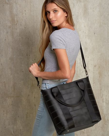 Nilza tote bag from Mamoq was crafted from repurposed seatbelts once destined for landfill. The lini