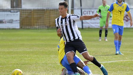 Tom Wood earned the crucial penalty as St Ives Town made progress in the FA Cup. Picture: DUNCAN LAM