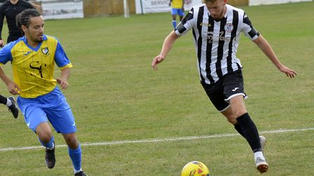 George Bailey on the ball for St Ives Town against Berkhamsted. Picture: DUNCAN LAMONT