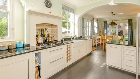 The kitchen provides a range of contemporary wall and floor units with modern integrated appliances,
