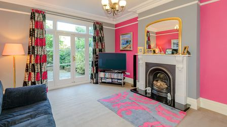 French doors lead to the rear garden from the spacious family room. Picture: Strutt & Parker