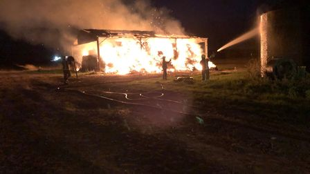 A fire in a Royston Road barn was spotted by firefighters on the way back from another fire. Picture