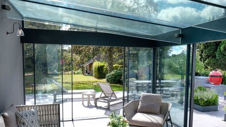 """Living in a box: Sliding doors and structural glass were used to create this """"Posterns Court"""" extens"""