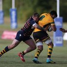 Jamie Townsend (c) of Old Albanian RFC tackles in the match between Old Albanian RFC v Bury St Edmon