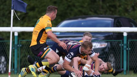 Dan Watt of Old Albanian RFC scores after Ned WarneÕs offload in the tackle in the match between Old