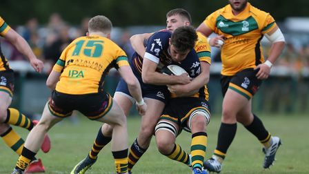 Alex Ricci of Old Albanian RFC holds on in the tackle in the match between Old Albanian RFC v Bury S
