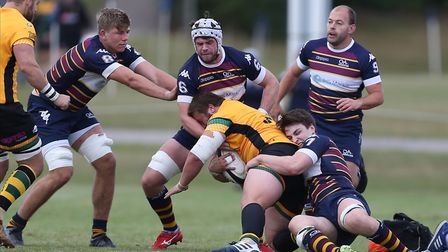Conor Gracey and Kay Minkiewicz of Old Albanian RFC tackle in the match between Old Albanian RFC v B