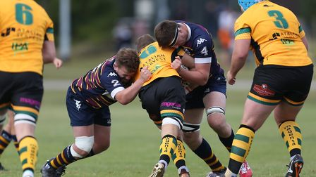 Josh Taylor and Tim Bond of Old Albanian RFC make a tackle in the match between Old Albanian RFC v B