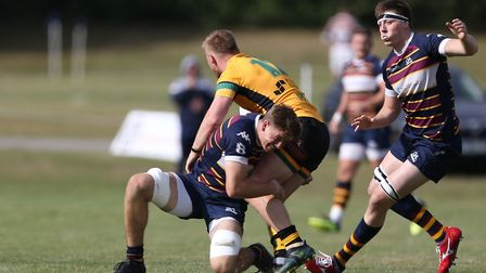 Ollie Stonham of Old Albanian RFC makes a tackle in the match between Old Albanian RFC v Bury St Edm