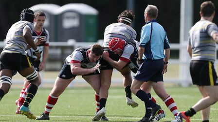 Ben Campion and Sean McLoughlin of Harpenden RUFC make a tackle in the match between Harpenden v Old
