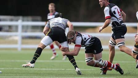 Tom Rolfe of Harpenden RUFC makes a tackle in the match between Harpenden v Old Priorians. Picture: