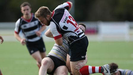 Matt Deane of Harpenden RUFC holds on in the tackle in the match between Harpenden v Old Priorians.