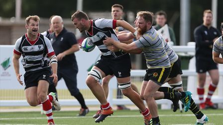 Ed Preston of Harpenden RUFC carries the ball forward in the match between Harpenden v Old Priorians