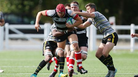 Ollie Lacey (c) of Harpenden RUFC carries the ball forward in the match between Harpenden v Old Prio