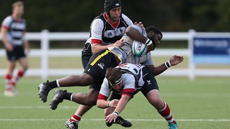 Michael Goode and Peter Sims of Harpenden RUFC make a tackle in the match between Harpenden v Old Pr