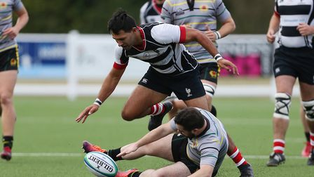 Bobby Tane of Harpenden RUFC forces a mistake in the match between Harpenden v Old Priorians. Pictur