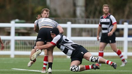Michael Goode of Harpenden RUFC makes a tackle in the match between Harpenden v Old Priorians. Pictu