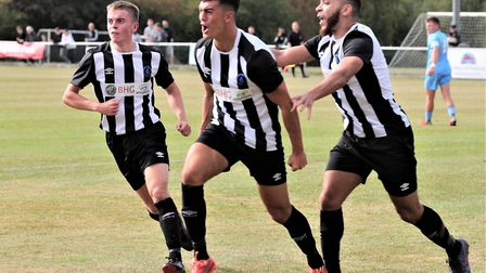 George Devine celebrates with Dom Knaggs and Chris Blunden after equalising for Colney Heath in thei