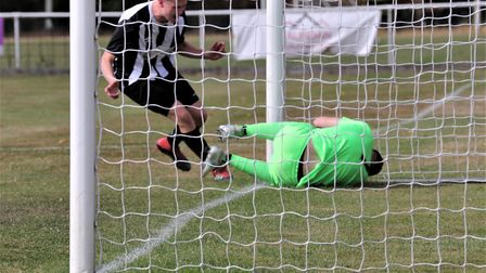 George Devine heads Colney Heath level in their FA Cup tie against Corby Town. Picture: JIM WHITTAMO