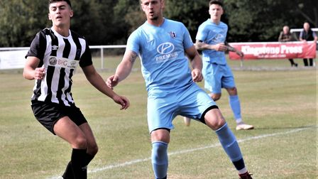 George Devine in action for Colney Heath in their FA Cup tie against Corby Town. Picture: JIM WHITTA