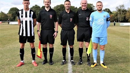 Captains Jack Woods and Jake Duffy line-up with the officials before Colney Heath took on Corby Town