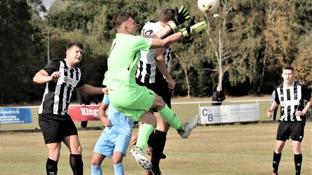 Harry Lewis in action for Colney Heath in their FA Cup tie against Corby Town. Picture: JIM WHITTAMO