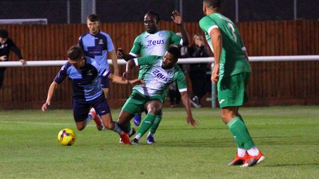 St Neots Town skipper Lee Watkins in the thick of the action at Biggleswade Town. Picture: DAVID R.
