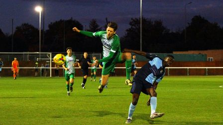 St Neots Town man Tim Nkala does battle during their FA Cup exit at Biggleswade Town. Picture: DAVID