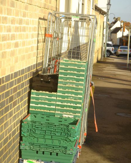 Metal crates left the back of Tesco Express last weekend. Picture: Ray Dowding