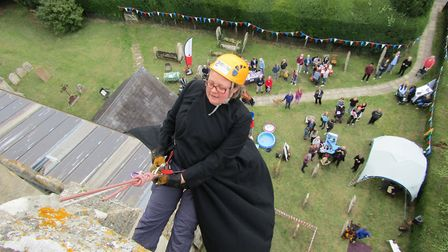 Revd Hannah Cleugh abseiled in her cassock. Picture: St Peter & St Paul, Bassingbourn