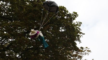 Bishop's Teddy Bear parachutes from the tower, dressed as a bishop. Picture: St Peter & St Paul, Bas
