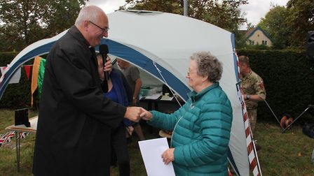 Bishop Stephen giving certificate to Anne Cross after she abseiled. Picture: St Peter & St Paul, Bas