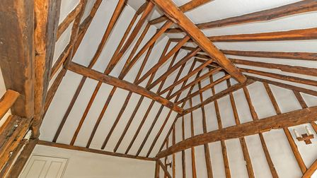There are exposed beams throughout the property. Picture: Cassidy & Tate