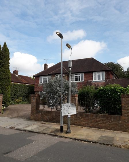 In Woodstock Road, HCC has erected a modern lamppost directly beside a historic column with a faulty