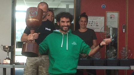 Rodrigo Santos of Riverside Runners lifts the Round Norfolk Relay trophy. Picture: SUBMITTED
