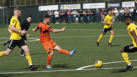 Ben Seymour-Shove gets in a strike at goal during St Ives Town's loss at Rushall Olympic. Picture: L