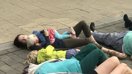 People from around Huntingdon took part in a die-in in the High Street
