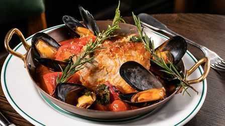 Braised steak of yellowfin tuna accompanied by mussels in a sauce of tomato, saffron, chilli, red pe
