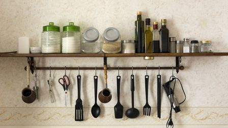 Anything that can be hung should be hung. Hooks on the undersides of shelves are a go-to for mugs, w