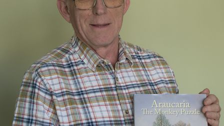 Bluntisham author David Gedye with a copy of Araucaria The Monkey Puzzle. Picture: CONTRIBUTED