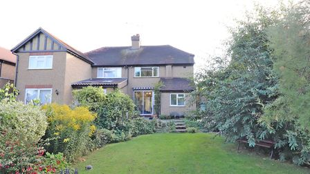 A paved patio area with steps leads down to the garden. Paul Barker Estate Agents