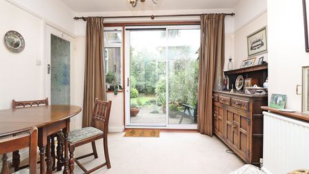 Double glazed sliding patio doors lead from the dining room to the rear garden. Paul Barker Estate A