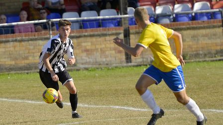 St Ives Town striker Dylan Wilson puts in the hard yards against Canvey Island. Picture: DUNCAN LAMO